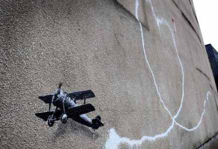 Banksy's Biplane: Love is in Liverpool.